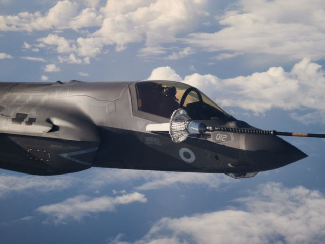 IN FLIGHT, SCOTLAND - OCTOBER 08: An F-35B combat aircraft from the Royal Air Force refuels from an RAF Voyager aircraft over the North Sea on October 08, 2020 in flight, above Scotland. The first air-to-air refuelling of F-35Bs from the newly-formed Carrier Strike Group took place as part of …
