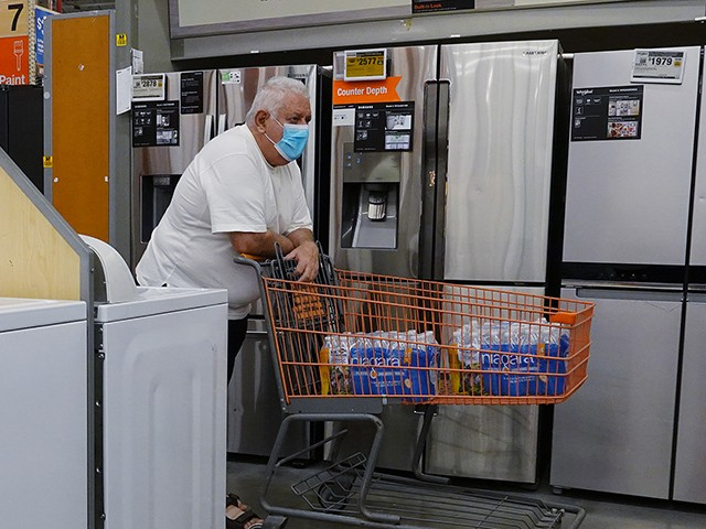 PEMBROKE PINES, FLORIDA - MAY 12: A customer in the appliance department at a Home Depot store on May 12, 2021 in Pembroke Pines, Florida. Reports indicate that consumer prices surged in April, with it attributed to a bottleneck in companies getting supplies for manufacturing and rising demand from consumers as the Covid-19 pandemic eases. (Photo by Joe Raedle/Getty Images)