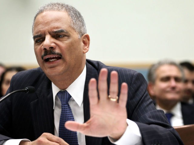 WASHINGTON, DC - MAY 15: U.S. Attorney General Eric Holder testifies during a hearing before the House Judiciary Committee on oversight of the U.S. Department of Justice May 15, 2013 on Capitol Hill in Washington, DC. Holder faced questions on reports of the subpoena of two months worth of Associated …