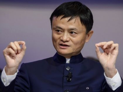 Alibaba Group Founder and Executive Chairman Jack Ma gestures as he speaks during a session of the World Economic Forum (WEF) annual meeting on January 23, 2015 in Davos. AFP PHOTO / FABRICE COFFRINI (Photo credit should read FABRICE COFFRINI/AFP via Getty Images)