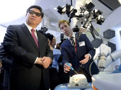 2LONDON, ENGLAND - OCTOBER 21: Chinese President Xi Jinping wears 3D glasses to view robotic equipment in the Hamlyn Centre for Medical Robotics during a visit to Imperial College on October 21, 2015 in London, England. The President of the Peoples Republic of China, Mr Xi Jinping and his wife, …