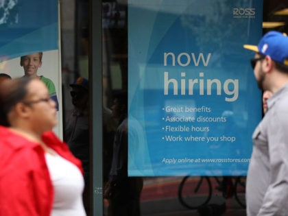 SAN FRANCISCO, CA - JULY 08: A 'now hiring' sign is posted outside of a Ross Dress for Less store on July 8, 2016 in San Francisco, California. According to the the U.S. Labor Department, employment growth surged with 287,000 added jobs in June. The unemployment rate inched up to …