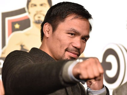 "WBO welterweight world champion Manny Pacquiao poses for the media following a press conference at his boxing gym in Tokyo on November 25, 2016. WBO welterweight world champion Manny Pacquiao on November 25 kept alive hopes for a rematch with Floyd Mayweather, saying the epic clash was ""possible"" but only …"