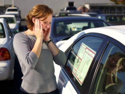 Woman car shopping experiences sticker shock