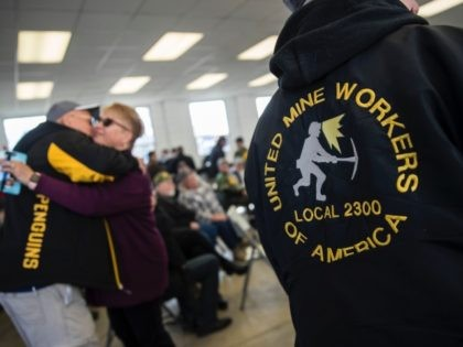 WAYNESBURG, PA - MARCH 11: United Mine Workers of America (UMWA) members attend a campaign rally for Conor Lamb, Democratic Congressional candidate for Pennsylvania's 18th district, at the Greene County Fairgrounds, March 11, 2018 in Waynesburg, Pennsylvania. Lamb is running in a tight race for the vacated seat of Congressman …