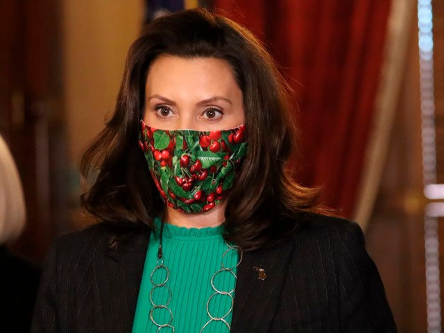 In this photo provided by the Michigan Office of the Governor, Gov. Gretchen Whitmer speaks during a news conference in Lansing, Mich., Thursday, Dec. 10, 2020. Whitmer, whose health department has prohibited indoor restaurant dining and closed various entertainment venues to limit the spread of the virus, announced that those …