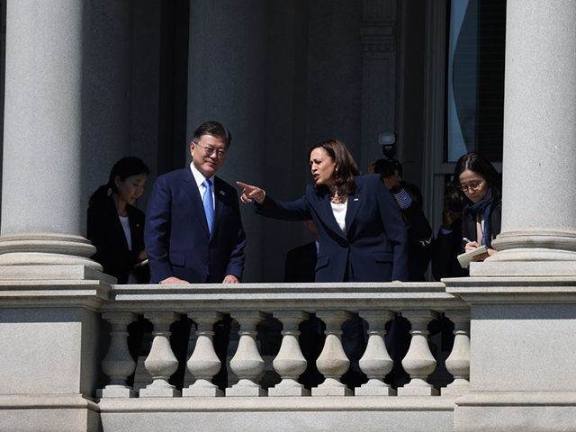 WASHINGTON, DC - MAY 21: U.S. Vice President Kamala Harris (R) and Korean President Moon Jae-in (L) look at the White House from a balcony of the Eisenhower Executive Office Building on May 21, 2021 in Washington, DC. Harris emphasized the Biden Administration's support for South Korea and maintaining Democracy …