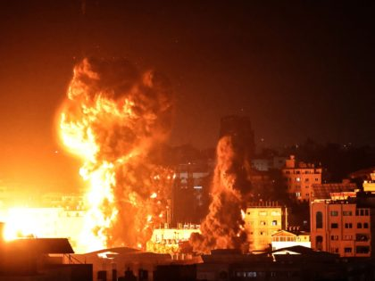TOPSHOT - Fire and smoke rise above buildings in Gaza City as Israeli warplanes target the Palestinian enclave, early on May 17, 2021. - Israeli warplanes bombarded the Gaza Strip overnight, said witnesses in the Palestinian enclave, from where armed groups have launched rockets into the Jewish state. (Photo by …