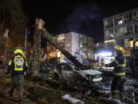 An Israeli firefighter works at the site where a rocket fired from the Gaza Strip, hit the central Israeli town of Holon, near Tel Aviv, Tuesday, May 11, 2021. A confrontation between Israel and Hamas sparked by weeks of tensions in contested Jerusalem escalated Tuesday as Israel unleashed new airstrikes …