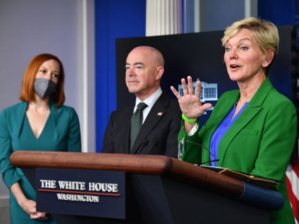 Secretary of Energy Jennifer Granholm holds a press briefing in the Brady Briefing Room of the White House in Washington, DC on May 11, 2021 as White House Press Secretary Jen Psaki(L) and Secretary of Homeland Security Alejandro Mayorkas look on. (Photo by Nicholas Kamm / AFP) (Photo by NICHOLAS …