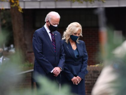 US President-elect Joe Biden and his wife Jill Biden pray during a Veterans Day stop at the Korean War Memorial Park in Philadelphia, Pennsylvania on November 11, 2020. - The leaders of close US allies on November 10, 2020 telephoned President-elect Joe Biden and pledged to work together but in …