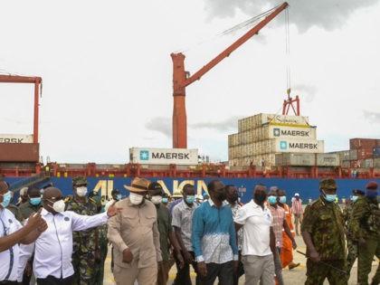 Kenya's President Uhuru Kenyatta (3rd L) arrives for the inauguration of the first berth at new Lamu Port, in Lamu, Kenya, on May 20, 2021. (Photo by Dihoff MUKOTO / AFP) (Photo by DIHOFF MUKOTO/AFP via Getty Images)