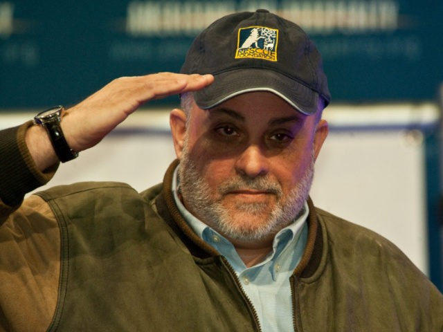 """Conservative radio host Mark Levin acknowledges the crowd after speaking at a """"Cut Spending Now"""" rally at the conservative Americans for Prosperity (AFP) """"Defending the American Dream Summit"""" in Washington on November 5, 2011. AFP PHOTO/Nicholas KAMM (Photo by Nicholas KAMM / AFP) (Photo by NICHOLAS KAMM/AFP via Getty Images"""