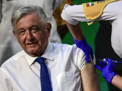 Mexican President Andres Manuel Lopez Obrador is inoculated with the first dose of the Astra Zeneca vaccine against COVID-19 after his daily morning press conference at the National Palace in Mexico City on April 20, 2021. (Photo by PEDRO PARDO / AFP) (Photo by PEDRO PARDO/AFP via Getty Images)