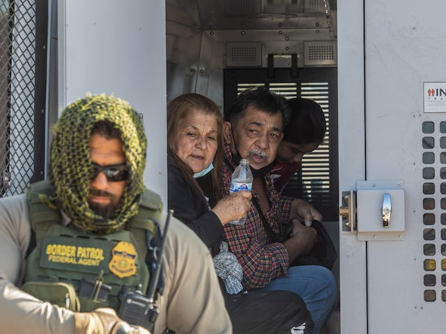 YUMA, AZ - May 13, 2021: A familiy of asylum seekers from Colombia are seeing inside a Border Patrol Inmate transport after they turns herselves to the US Border Patrol Agents on May 12, 2021 in Yuma, Arizona. Migrants Continue To Cross Southern Border As Biden Administration Grapples With Surge. …