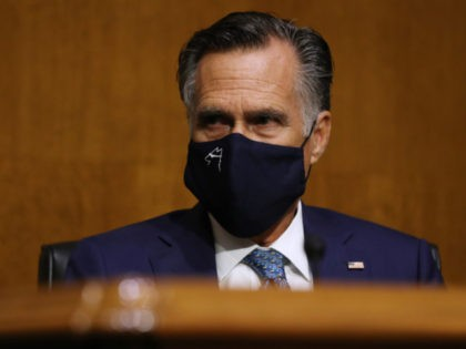 Wearing ammask to reduce the risk of spread of the novel coronavirus, Senate Foreign Relations Committee member Sen. Mitt Romney (R-UT) attends a hearing about Venezuela in the Dirksen Senate Office Building on Capitol Hill August 04, 2020 in Washington, DC. Senators questioned State Department Special Representative for Venezuela Elliot …