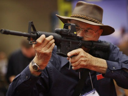 WWII veteran Ray Cahow, 82, checks out an ArmaLite rifle at the National Rifle Association of America's (NRA) annual meeting at the Kentucky Exposition Center May 16, 2008 in Louisville, Kentucky. The annual meeting and exhibits for the NRA, which boasts about 4 million members, will run through May 18. …
