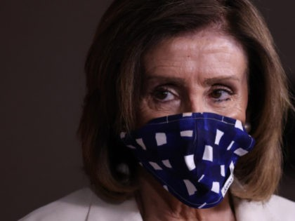 Speaker of the House Nancy Pelosi (D-CA) wears a cloth mask to cover her mouth and nose to prevent the spread of the novel coronavirus during her weekly news conference at the U.S. Capitol April 30, 2020 in Washington, DC. While she and Democratic House leaders are not going to …
