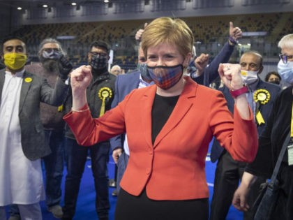 First Minister and SNP party leader Nicola Sturgeon celebrates after retaining her seat for Glasgow Southside at the count for the Scottish Parliamentary Elections in Glasgow, Scotland, Friday May 7, 2021. On winning her seat in Glasgow, Nicola Sturgeon, said early results indicated that her party was on course to …