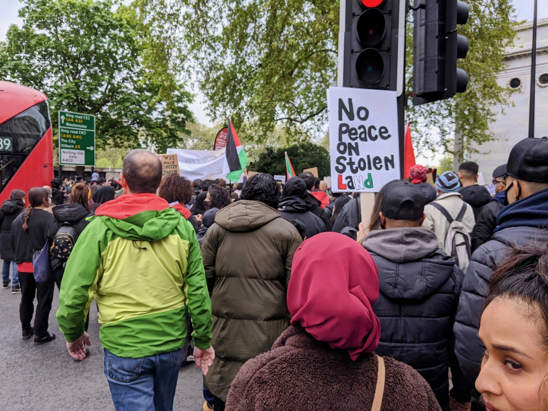 """A protester is seen carrying a placard reading """"No Peace on Stolen Land"""", at an anti-Israel protest in London. May 15th, 2021. Kurt Zindulka, Breitbart News"""