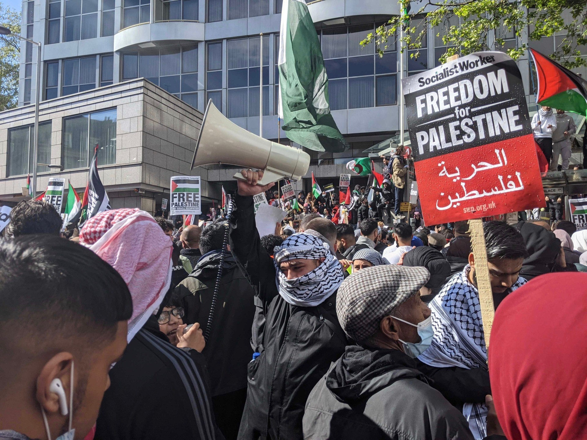 """A protester is seen carrying a Socialist Worker placard reading """"Freedom for Palestine"""", at an anti-Israel protest in London. May 15th, 2021. Kurt Zindulka, Breitbart News"""