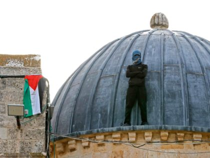 A Palestinian protester stands atop Al-Aqsa mosque in Jerusalem on May 10, 2021, ahead of a planned march to commemorate Israel's takeover of Jerusalem in the 1967 Six-Day War. (Photo by Ahmad GHARABLI / AFP) (Photo by AHMAD GHARABLI/AFP via Getty Images)