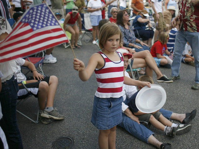 Parade goers watch floats as he Independence Day parade makes its way through Wimberley, Texas on July 4, 2008. (Ben Sklar/Getty Images)