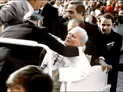 Bodyguards hold Pope John Paul II (C) after he was shot 13 May 1981 on Saint Peter's square by a Turkish extremist Mehmet Ali Agca. Agca was jailed for 19 years in Italy for the attack on the Pope, which left the head of the Roman Catholic church seriously wounded. …