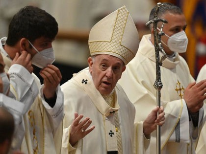 Pope Francis talks to nine newly-ordained priests as they pose for a group photo, asking them them to take off their face mask, at the end of an ordination mass on April 25, 2021 at St. Peter's Basilica in The Vatican, during which Pope Francis ordained nine new priests for …