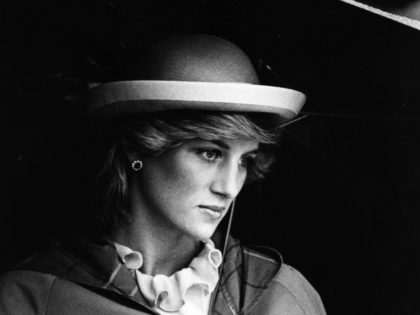 Lady Diana Spencer (1961 - 1997), future Princess of Wales sheltering under an umbrella. (Photo by Hulton Archive/Getty Images)
