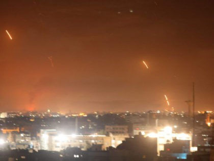 Rockets are launched towards Israel from Rafah, in the southern Gaza Strip, early on May 12, 2021. - Palestinian militants Hamas said on May 12 that they had fired more than 200 rockets into Israel, in retaliation for strikes on a tower block in the Israeli-blockaded enclave of Gaza, which …