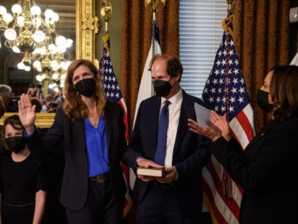 US Vice President Kamala Harris (R) applauds after swearing in Samantha Power (3-L) as Administrator of the United States Agency for International Development (USAID), as her husband Cass Sunstein, daughter Rian Power Sunstein and son Declan Power Sunstein look on at the White House in Washington, DC, on May 3, …