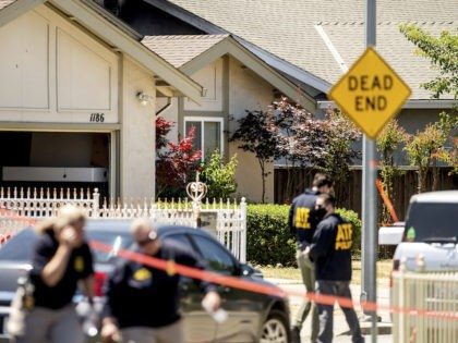 FBI agents approach a home, rear, being investigated in connection to a shooting at a Santa Clara Valley Transportation Authority (VTA) facility on Wednesday, May 26, 2021, in San Jose, Calif. A Santa Clara County sheriff's spokesman said a shooting at the rail yard left at least eight people, including …