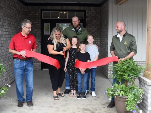 The Zurn family receives their new home from Operation Finally Home and JM Dungan Custom Homes. Screenshot via Twitter.