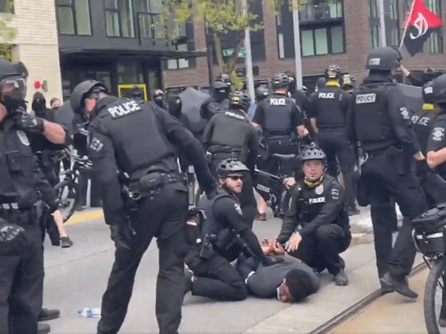 Antifa Assaults Child, Police In Seattle Riot