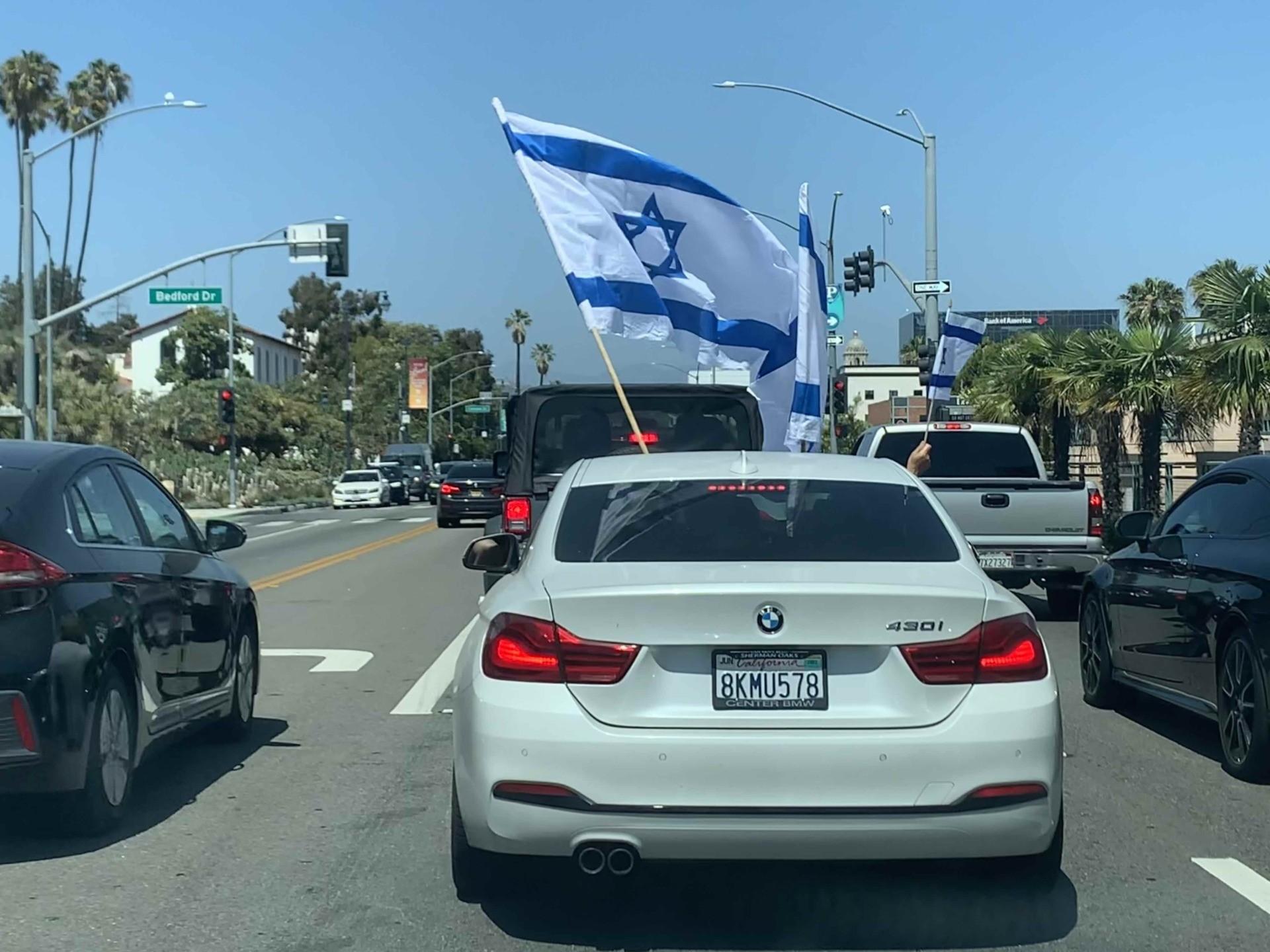 Sunroof flag at pro-Israel rally (Joel Pollak)