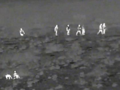 A Border Patrol K-9 team tracks a group of migrants. A mobile surveillance vehicle captures the events. (Image: U.S. Border Patrol/Del Rio Sector)