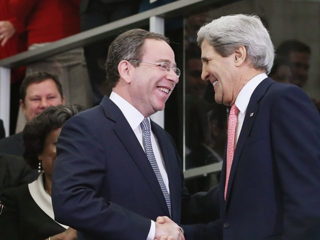 WASHINGTON, DC - FEBRUARY 04: U.S. Secretary of State John Kerry (R) greets Deputy Secretary of State for Management and Resources Thomas Nides in the C Street Lobby during his first day at the State Department February 4, 2013 in Washington, DC. Kerry said he would work closely with President …