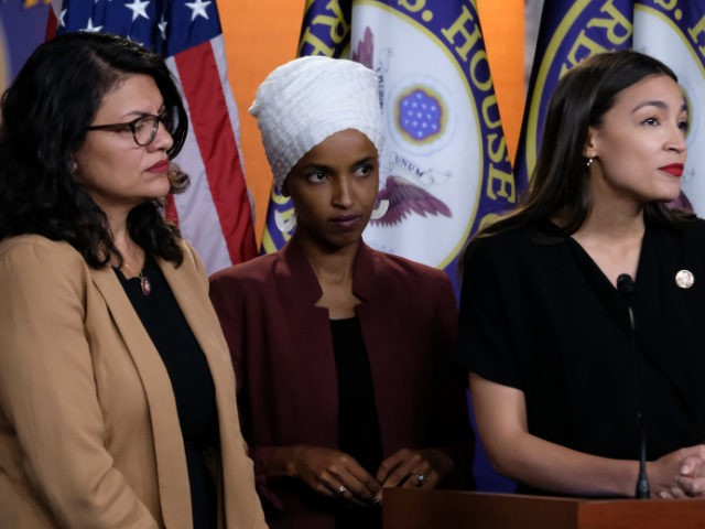WASHINGTON, DC - JULY 15: U.S. Reps. Rashida Tlaib (D-MI), Ilhan Omar (D-MN) and Alexandria Ocasio-Cortez (D-NY) listen during a news conference at the U.S. Capitol on July 15, 2019 in Washington, DC. President Donald Trump stepped up his attacks on the four progressive Democratic congresswomen, saying that if they're …