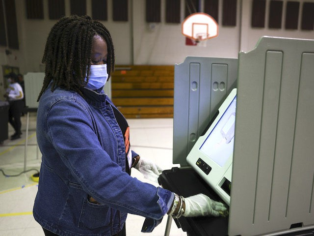 Poll manager Sheila Tyson sanitizes a voting booth on Election Day on November 3, 2020 in Orangeburg, South Carolina. After a record-breaking early voting turnout, Americans head to the polls on the last day to cast their vote for incumbent U.S. President Donald Trump or Democratic nominee Joe Biden in …