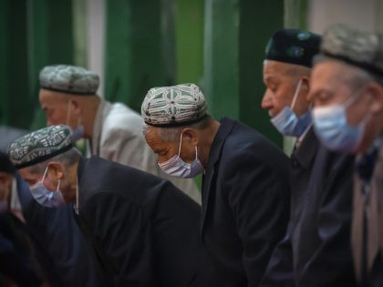 Uyghurs and other members of the faithful pray during services at the Id Kah Mosque in Kashgar in western China's Xinjiang Uyghur Autonomous Region, as seen during a government organized visit for foreign journalists, Monday, April 19, 2021. Under the weight of official policies, the future of Islam appears precarious …