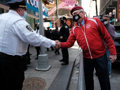 NEW YORK, NEW YORK - APRIL 20: Curtis Sliwa, the founder and chief executive officer of the Guardian Angels, joins other members of the group as they congregate in Times Square near a police precinct as security throughout the city is increased ahead of a verdict in the Derek Chauvin …