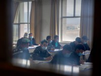 Uyghurs and other students attend a class at the Xinjiang Islamic Institute, as seen during a government organized visit for foreign journalists, in Urumqi in western China's Xinjiang Uyghur Autonomous Region on April 22, 2021. Under the weight of official policies, the future of Islam appears precarious in Xinjiang, a …