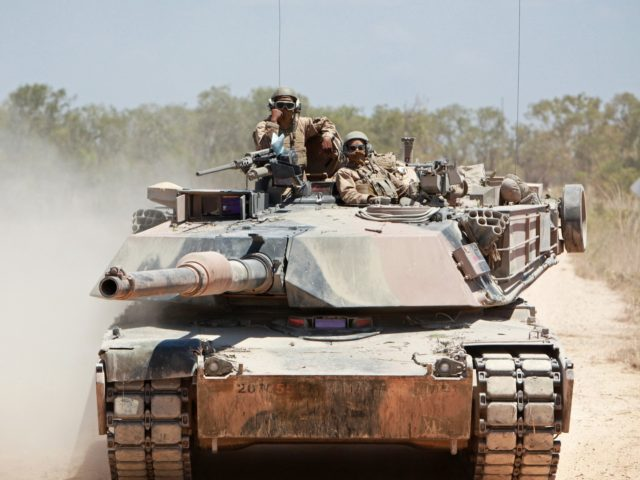 MOUNT BUNDEY TRAINING AREA, Northern Territory, Australia – Marines with Alpha Company, 1st Tank Battalion, engage a target from an M1A1 Abrams Main Battle Tank during Exercise Gold Eagle 2013, here, Sept. 14. The exercise is an annual, reciprocal, company-level military exchange between the Australian Army and the Marine Corps. …