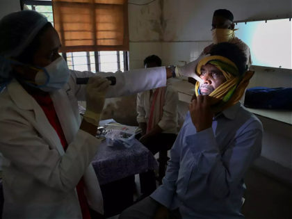 An Indian doctor checks a man who recovered from COVID-19 and now infected with black fungus at the Mucormycosis ward of a government hospital in Hyderabad, India, Thursday, May 20, 2021. (AP Photo/Mahesh Kumar A.)