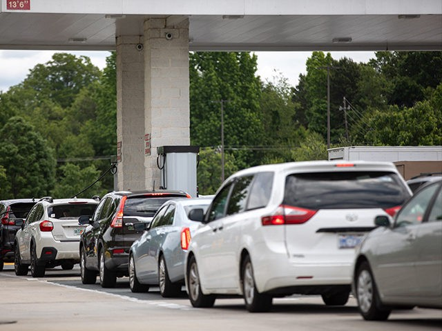 Cars line up to fill their gas tanks at a COSTCO at Tyvola Road in Charlotte, North Carolina on May 11, 2021. - Fears the shutdown of a major fuel pipeline would cause a gasoline shortage led to some panic buying and prompted US regulators on May 11, 2021 to …
