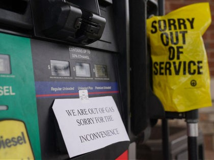 A sign warns consumers on the avaliability of gasoline at a RaceTrac gas station on May 11, 2021, in Smyrna, Georgia. - Fears the shutdown of a major fuel pipeline would cause a gasoline shortage led to some panic buying and prompted US regulators on May 11, 2021 to temporarily …