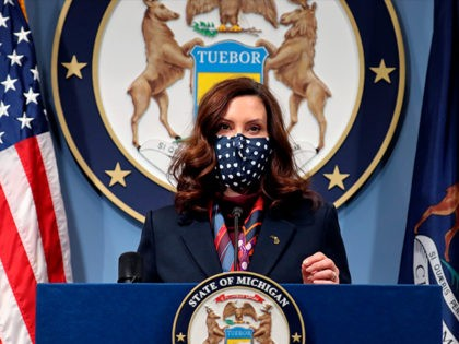 In a photo provided by the Michigan Office of the Governor, Gov. Gretchen Whitmer addresses the state during a speech in Lansing, Mich., Tuesday, March 2, 2021. The governor announced the further loosening of Michigan's coronavirus restrictions, easing capacity limits in restaurants and a host of other businesses while also …
