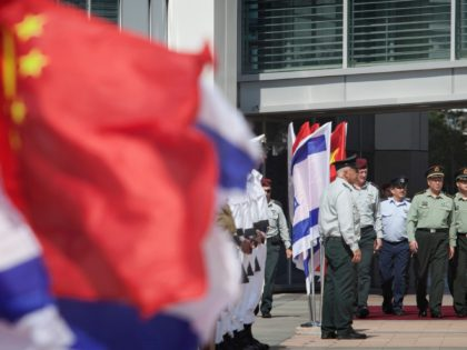 Gen. Chen Bingde, left, chief of the General Staff of the Chinese People's Liberation Army, third from right, and Israeli Chief of Staff Lt. Gen. Benny Gantz, fifth from right, review an honor guard during a welcoming ceremony in a military base in Tel Aviv, Sunday, Aug. 14, 2011. After …