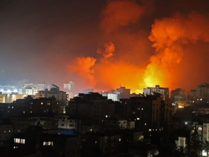 Fire erupts from the Andalus Tower as it is destroyed by an Israeli airstrike in Gaza City, controlled by the Palestinian Hamas movement, early on May 16, 2021. - Israel pummelled the Gaza Strip with air strikes, killing 10 members of an extended family and demolishing a building housing international …